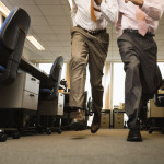 Two Businessmen Running in Office